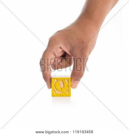 Hand Holding Colorful Alphabet Blocks