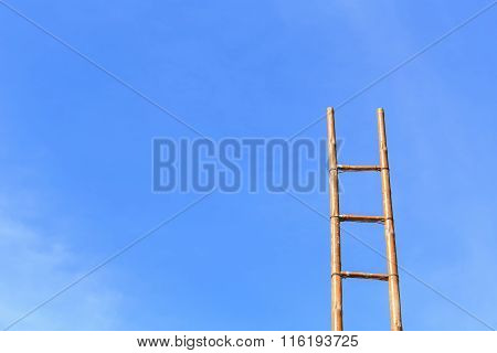 Long Bamboo Ladder And Blue Sky