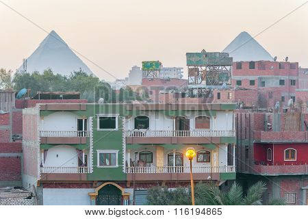 Houses In Cairo And Pyramids Of Giza At The Background
