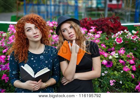 Romantic Girlfriend Reading A Book In Park.