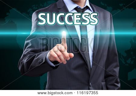 businessman hand pushing success button on a touch screen interface. Business,  technology concept.