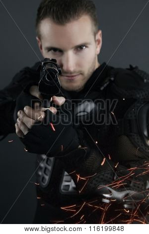 super cops - blond man posing with a gun