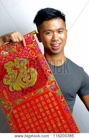 Young Asian Man wishing happiness for chinese new year