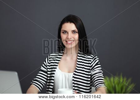 Beautiful business woman working at her desk withlaptop