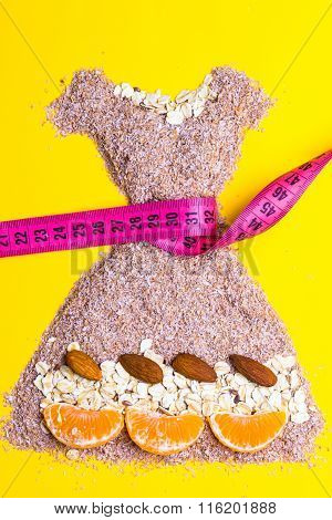 Dress Shape Made From Bran With Measure Tape