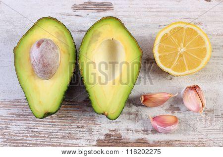 Avocado, Garlic And Lemon On Wooden Background, Ingredient Of Avocado Paste Or Guacamole, Healthy Fo