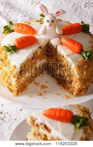 Carrot Cake Decorated With Bunny And Slice Close-up. Vertical