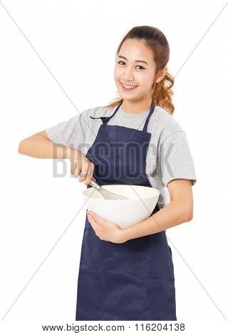 Young Woman With Whisk And Bowl Isolated On White.