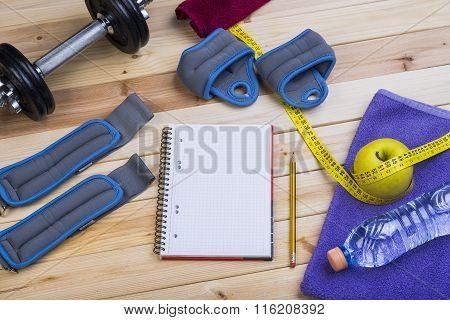 Dumbbells, Weights, Towel, Water, Notebook.
