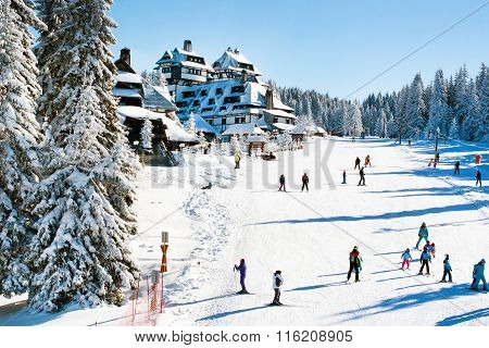 Panorama of ski resort Kopaonik, Serbia, people, houses, restaurants