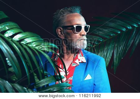 Businessman Between Palms Looking Into Distance