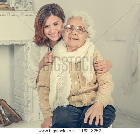 portrait of grandmother and granddaughter in interior