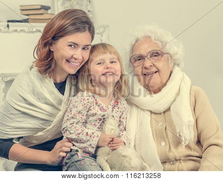 greatgrandmother with two greatgranddaughter and granddaughter  portrait