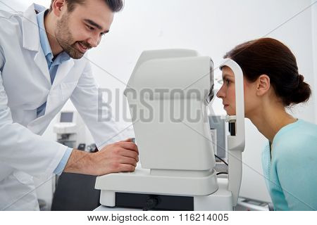 optician with tonometer and patient at eye clinic