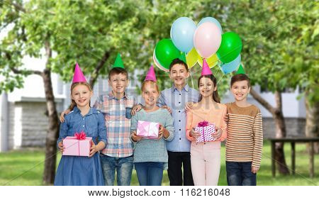 happy children with gifts on birthday party