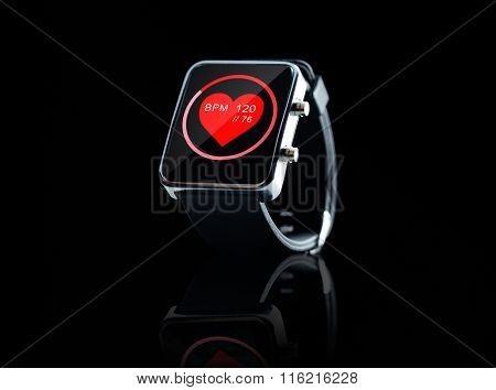 close up of black smart watch with heart beat icon