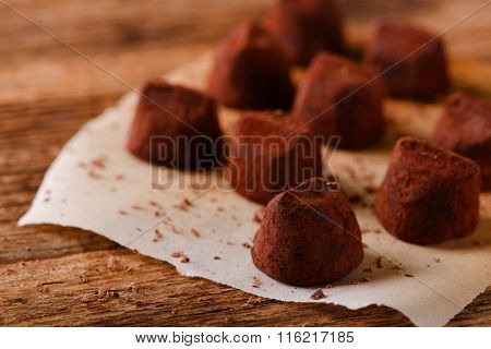 Chocolate Truffles On Piece Of Paper Sheet