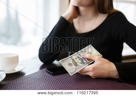 Woman Holding A One Hundred Dollar Bill