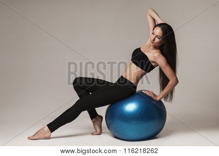 Young Attractive Woman Exersicing With Fitness Ball