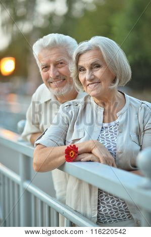 smiling old couple with flower