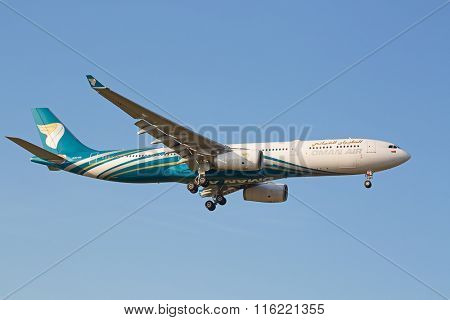 ZURICH - JULY 18: Oman Air A-330 landing in Zurich airport on July 18, 2015 in Zurich, Switzerland. Zurich airport is home port for Swiss Air and one of the biggest european hubs.