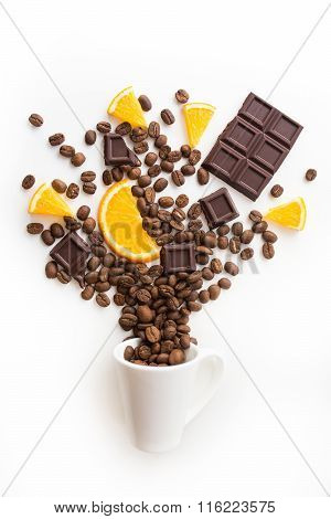 cup filled coffee beans with chocolate and orange