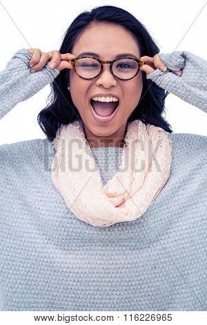 Asian woman holding eyeglasses on white screen