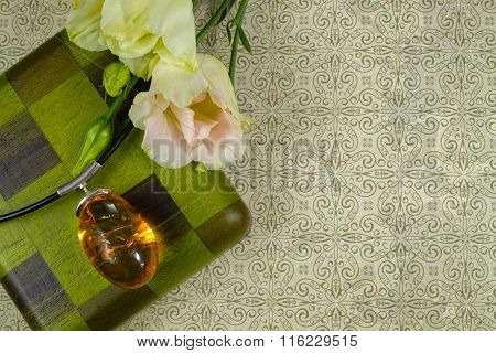 Big yellow amber with white  flowers and green wooden box, copy space