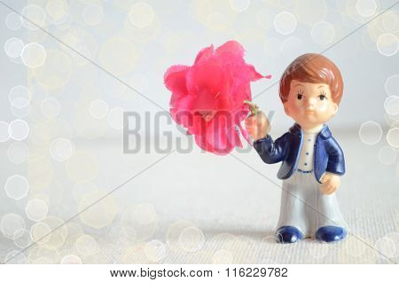 Valentine Greeting Card With Romantic Boy Figurine With Bouquet Of Flowers
