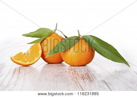 Tangerine On White Wooden Table. Provence Style.