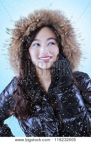 Cheerful Girl Wearing Winter Clothes