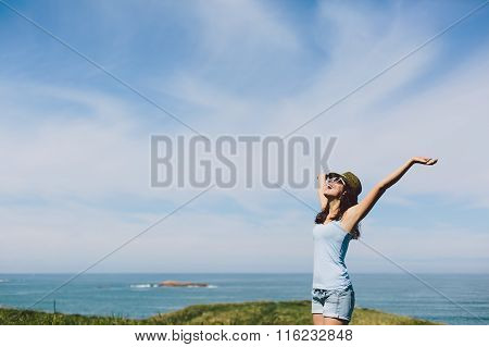 Blissful Woman Enjoying Coast Vacation Travel