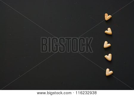 Crackers Hearts On Dark Wooden Table