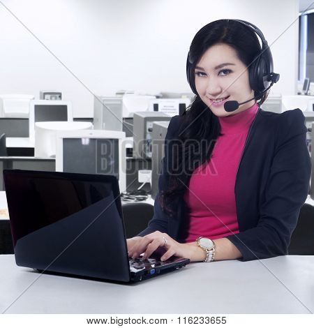 Friendly Helpline Operator Working In Office