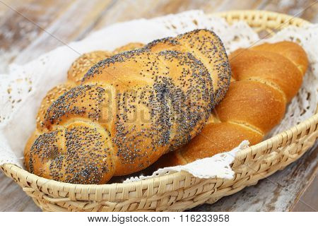 Challah bread with poppy seeds, sesame seeds and plain in bread basket