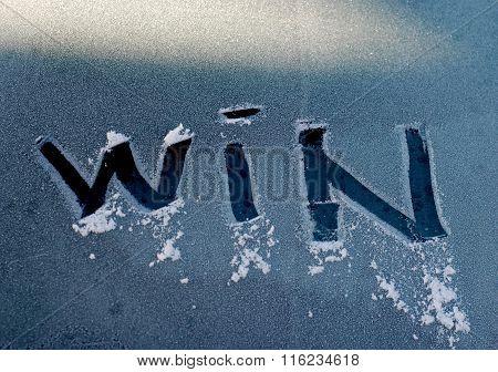 Text Win On A Frosty Window