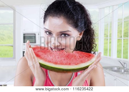 Woman Biting Fresh Watermelon