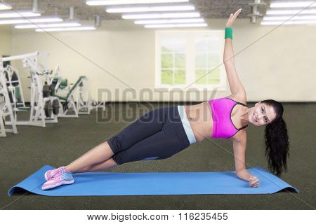Woman Doing Side Plank Pose At Gym