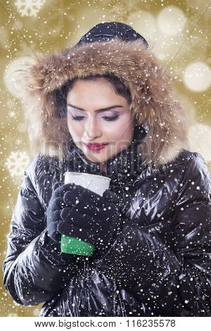 Woman With Winter Coat And Holds Hot Coffee