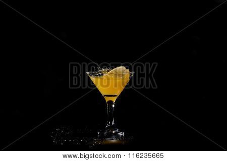 Glass Of Fruit, Citrus Juice With A Slice Of Orange On A Black Table
