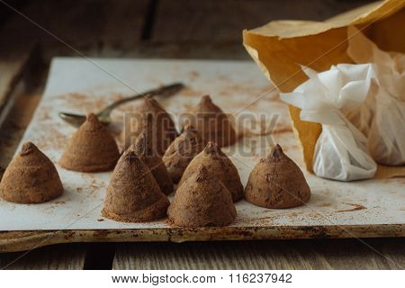 Artisanal Truffles On Cooking Paper Over Backing Tray