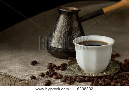 Cup Of Black Coffee, Brewing Pot And Coffee Beans