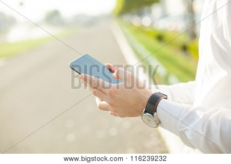 Close up of young man hands using touchscreen on digital tablet