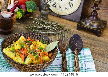 Steamed vegetables potatoes, carrots, corn, green beans, onio