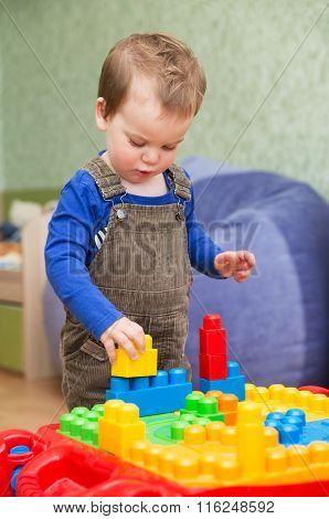 Little Boy Playing In The Children's Designer