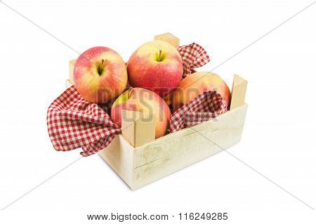 apples on wooden box  on white