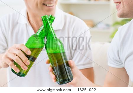 Father and adult son drinking beer