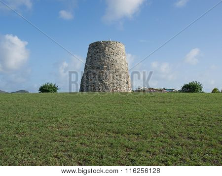 Sugar Mill On A Grassy Hill