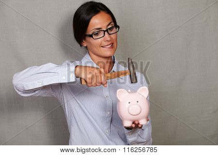 Adult Female Holding And Breaking Money Box