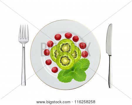 Plate With Kiwi Slices, Cranberry And Mint Herb, Knife And Fork Isolated On White